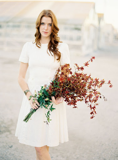 Kate loves how this bouquet blends the timeless elegance of form and line with a very passionate deep, dark tone.