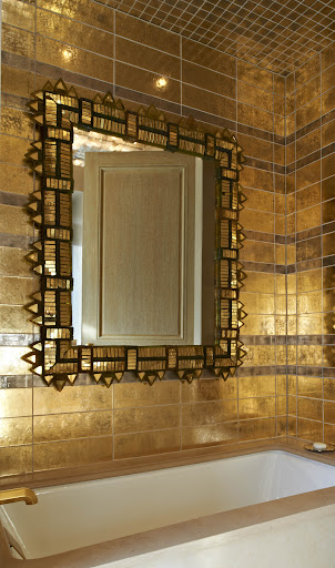 These metallic tiles are very glamorous in the bath. (Photo by Michael Mundy)