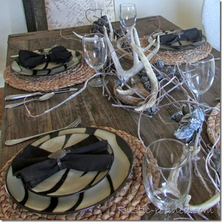 Rustic and refined tablescape using animal print dishes for a woodland theme
