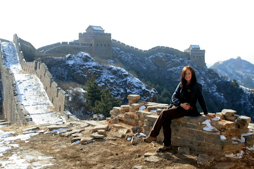 Lynette enjoying a breather on the Great Wall of China.