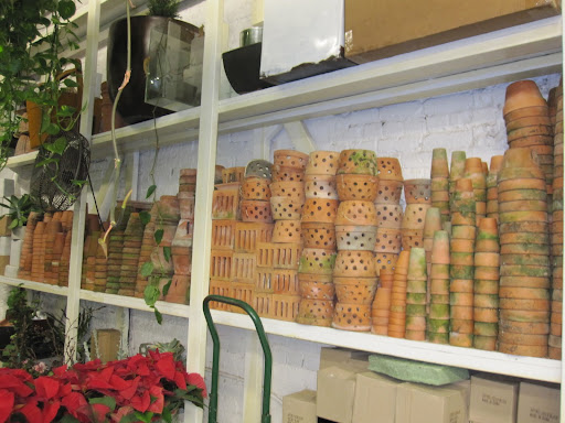 A variety of pots are stacked throughout the store.