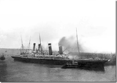 "The ""New York"" being pushed away from the Titanic by tugs following the snapping of the cables."