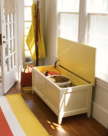 A storage bench with a hinged lid is handy to have in the mudroom, entryway, or kitchen, and it can be just the right spot for pet supplies.