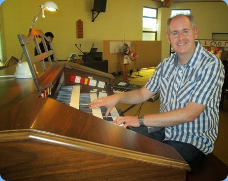 Chris Powell checking-out the Allen TH300 Theatre Organ during preparations for the Concert. Photo courtesy of Dennis Lyons.