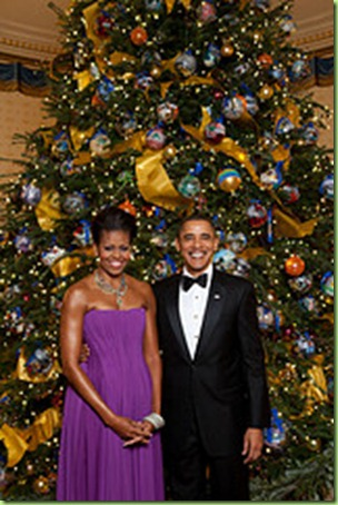 President Barack Obama and First Lady Michelle Obama pose for a formal portrait in front of the official White House Christmas Tree in the Blue Room of the White House, Dec. 6, 2009. (Official White House Photo by Lawrence Jackson)  This official White House photograph is being made available only for publication by news organizations and/or for personal use printing by the subject(s) of the photograph. The photograph may not be manipulated in any way and may not be used in commercial or political materials, advertisements, emails, products, promotions that in any way suggests approval or endorsement of the President, the First Family, or the White House.