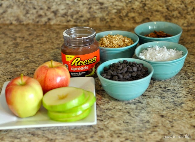 Build Your Own Apple Snack Bar with apple rings, Reese's Spreads, and toppings. Kids can top however they like for a fun, unique snack