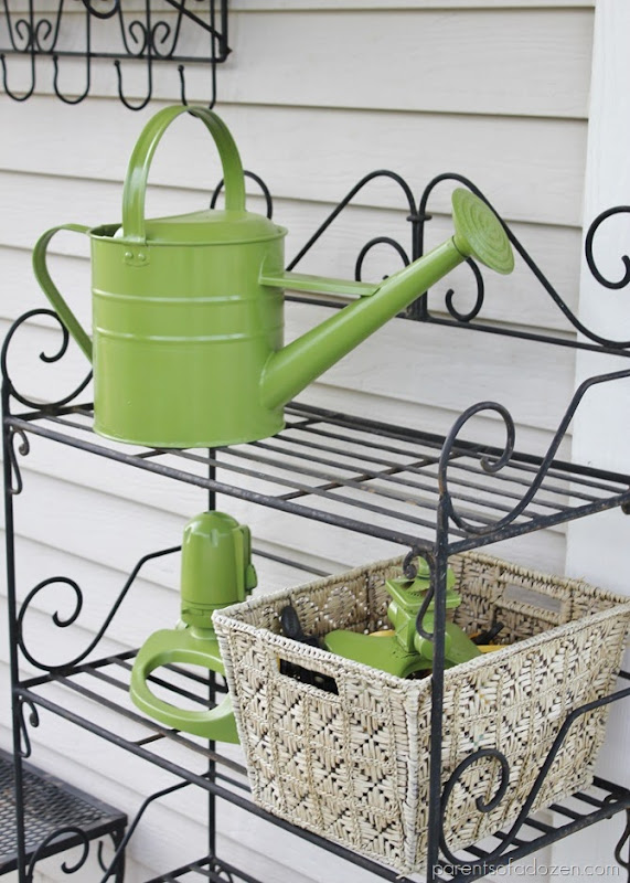 Spray painting watering can and sprinklers to add color and to refresh