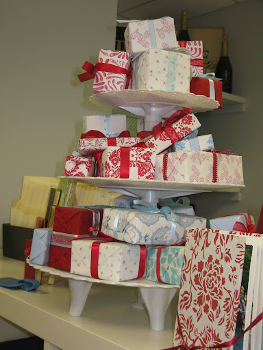 A tiered pedestal held neatly wrapped gifts.