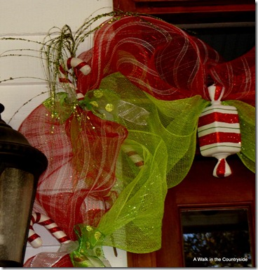 A Walk in the Countryside: Christmas Front Door decorated in candy and mesh ribbon