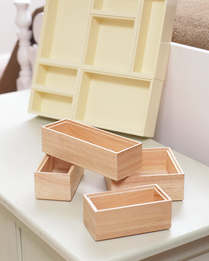 Kitchen drawer organizers can be painted and glued together for a custom tray to hold desk supplies.