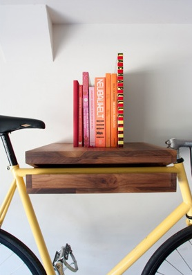 This piece does double duty as both a bike rack and a shelf. (Bike Shelf, Knife and Saw on etsy.com)