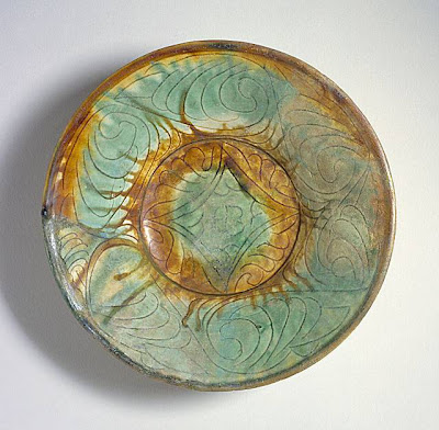 Bowl Iran, Nishapur Bowl, 10th century Ceramic; Vessel, Earthenware, incised, splashes of color in transparent glaze, 2 1/2 x 8 1/2 in. (6.35 x 21.59 cm) The Nasli M. Heeramaneck Collection, gift of Joan Palevsky (M.73.5.148) Art of the Middle East: Islamic Department.