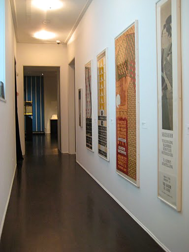 Old advertising prints from the 1900's line one of the corridors between galleries.