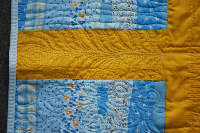 Yellow Improv Quilt Quilting Feather