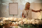 Kimmy Crosby teaches guests how to accessorize small bouquets.
