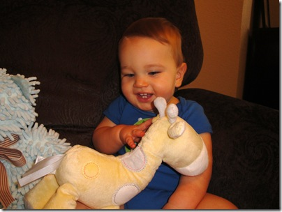 7.  Knox smiling with Giraffe