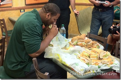 Ndamukong Suh eats a turkey and avocado Subway sandwich
