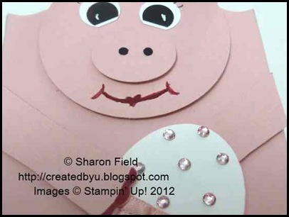 Rose red pig lips and painted toe nails on pig box