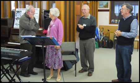 President of the St Annes Club for the Blind, Colleen Clemow, thanks George Watt for his 24 years of service to the St Annes Club and on behalf of the North Shore Organ and Keyboard Club. Peter Brophy and Len Hancy from the NSOKC watch on with respect.