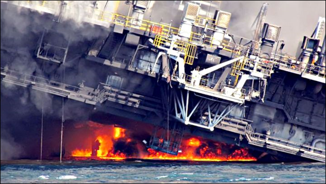 The off shore oil rig Deepwater Horizon burns in the Gulf of Mexico, 21 April 2010. Photo: Jon T. Fritz / AP