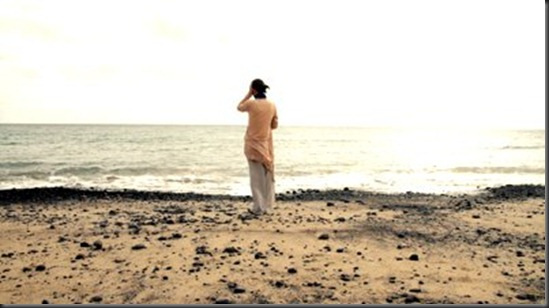 woman-standing-on-the-seashore