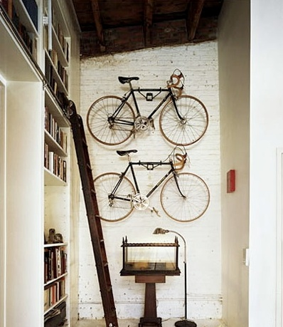 The vintage bikes pair well with the brick accent wall. (remodelista.com)