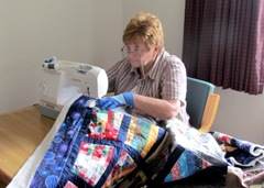 Barb Quilting In Hotel Room