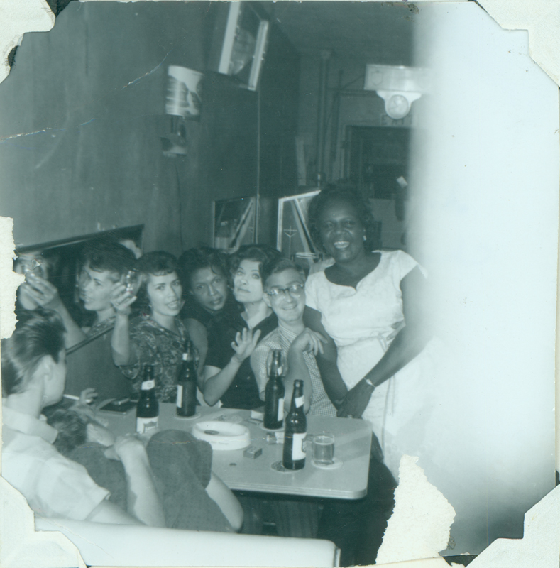"Patrons gather at Mary Ellen Mitchell's Top Hat.The people facing the camera are (left to right) Anita, Trudy, Carolyn Weathers, Charles, and Mary Ellen. Mary Ellen was assigned as President of the ""Un Cappa-Fu"" society of which Carolyn Weathers was a member. Spring 1963."