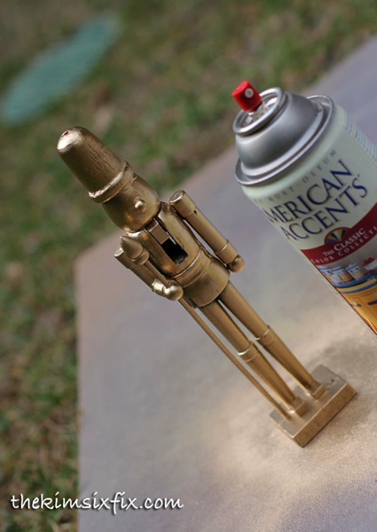 Spray paint nutcracker gold