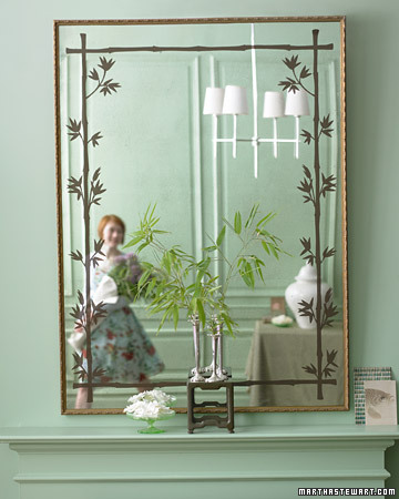 This mirror -- embellished with a stenciled overlay of glass -- looks like an heirloom. (marthastewart.com)