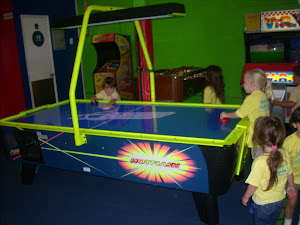 Penguins enjoying a game of air hockey!
