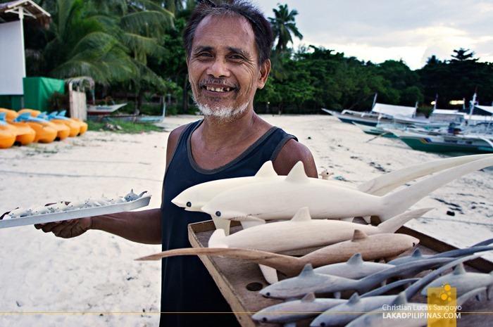 A Vendor Selling Thresher Shark Souvenirs at Malapascua's Bounty Beach