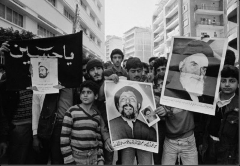 Demonstration of the Shiite political movement in Beirut. Protestants hold posters of Lebanese resistance leader and Muslim cleric Ragheb Harb