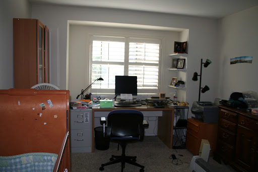 The second bedroom with desk and bookcase. It currently has a crib in it for our baby. It also doubles as our office.