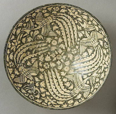 Bowl with Four Phoenixes Iran, Sultanabad Bowl with Four Phoenixes, 14th century Ceramic; Vessel, Fritware, green-gray slip, underglaze-painted, 8 1/2 x 4 in. (21.5 x 10.2 cm) The Nasli M. Heeramaneck Collection, gift of Joan Palevsky (M.73.5.215) Art of the Middle East: Islamic Department.