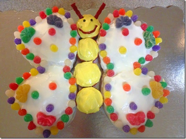 Butterfly Birthday Cake - Small heart cakes for the wings, cupcakes for the body, twizzler antennae and mouth, and mini chocolate chip eyes