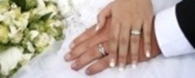 8600801-loving-couple-holding-hands-with-rings-against-wedding-dress