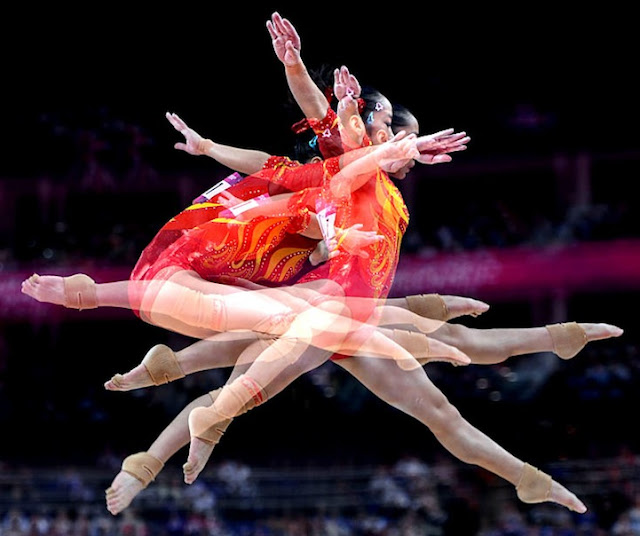 LONDON, ENGLAND JULY 29, 2012-2012-Shot with a multiple exposure China's Linlin Deng competes on the beam during the Women's Individual Qualification in the 2012 London Olympics Sunday.  (Wally Skalij/Los Angeles Times)