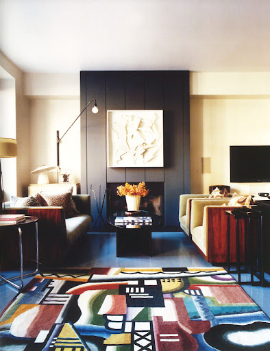 The artist Kazumi's living room, with Art Deco furniture, a Declercq tapestry on the floor, and one of his sculptures above the fireplace.