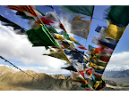 Tibetan prayer flags fly over the city of Leh at 12,000 ft above sea level in Ladakh, India. <em>© Paula Bronstein</em>