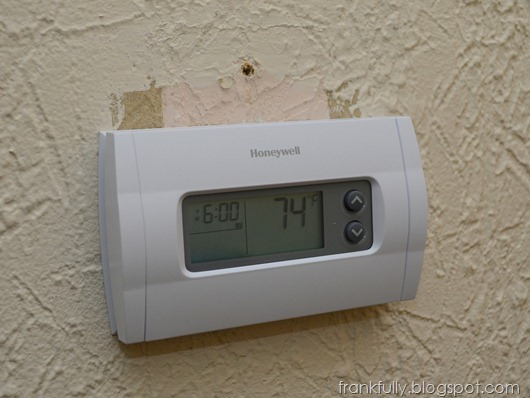 new thermostat! wall needs some touch up paint!