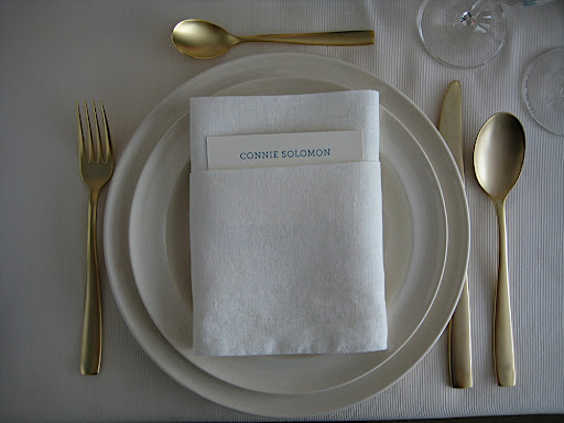 A close up of the place setting, which included the Midas Gold flatware from The Conran Shop, and a sweet little place card tucked into the napkin.