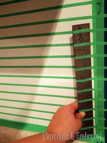Use this tape trick to get perfect lines for painting your backsplash.