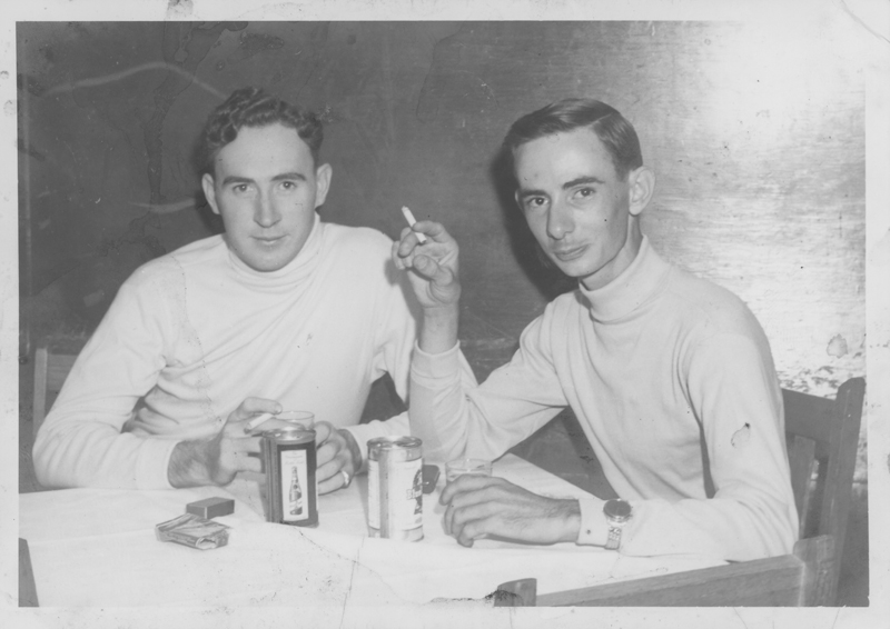 Dirk (left) and Edgar Sandifer at a restaurant table. Circa 1950s.
