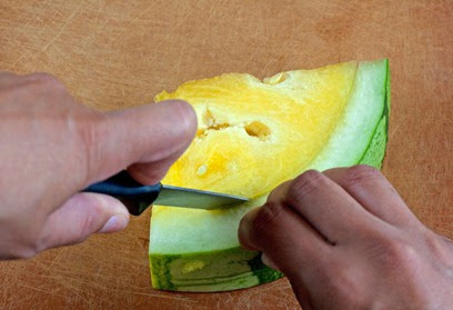 Cutting the watermelon along the rind