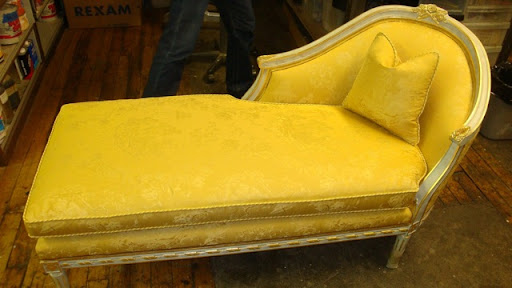 ...and after! The bright yellow pattern is so striking. A single, simple pillow keeps the whole piece looking relaxed.