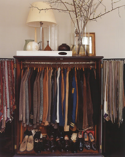 His collection of vintage clothing, held within a rare 19th Century Hudson River Valley armoire.