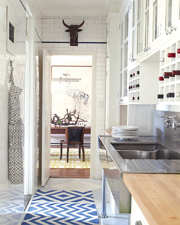 I like how this white kitchen is anything but sterile and cold, thanks to a runner and a fun bull's-head sculpture.