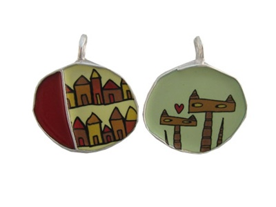 And this reversible pendant makes a perfect gift those loyal dedicated cat lovers who look out for the neighborhood cats who need love too!