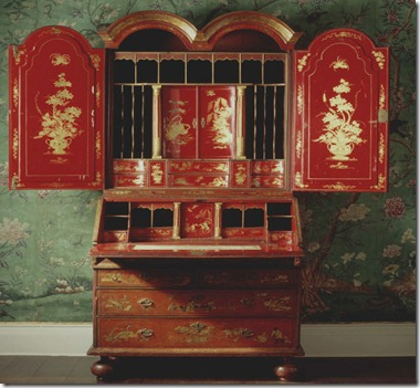The red japanned bureau bookcase found in the State Bedroom at Erddig, Wrexham, Wales